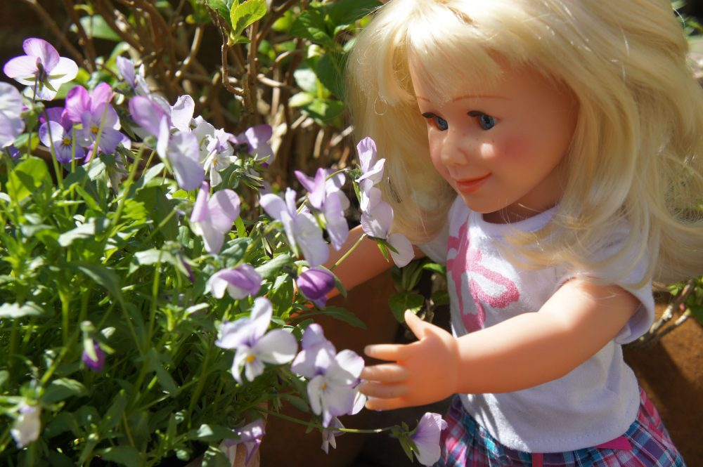 doll with pansies