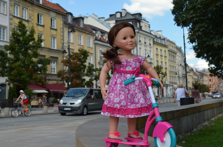 doll on scooter