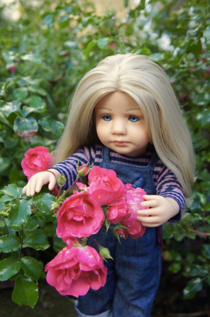 Lotta admiring the roses